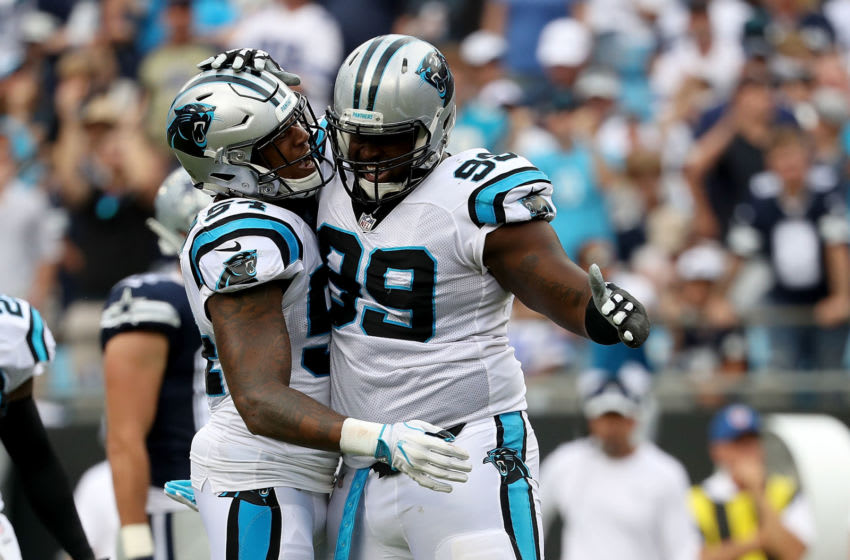 CHARLOTTE, NC - SEPTEMBER 09: Kawann Short #99 and teammate Shaq Green-Thompson #54 of the Carolina Panthers react after a sack against the Dallas Cowboys in the second quarter during their game at Bank of America Stadium on September 9, 2018 in Charlotte, North Carolina. (Photo by Streeter Lecka/Getty Images)
