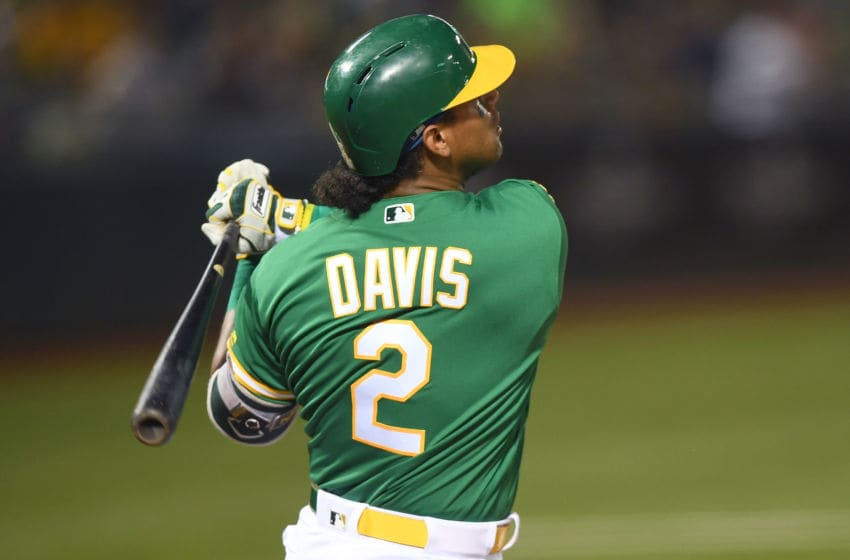 OAKLAND, CA - SEPTEMBER 21: Khris Davis #2 of the Oakland Athletics hits a two-run home run against the Minnesota Twins in the bottom of the first inning at Oakland Alameda Coliseum on September 21, 2018 in Oakland, California. (Photo by Thearon W. Henderson/Getty Images)