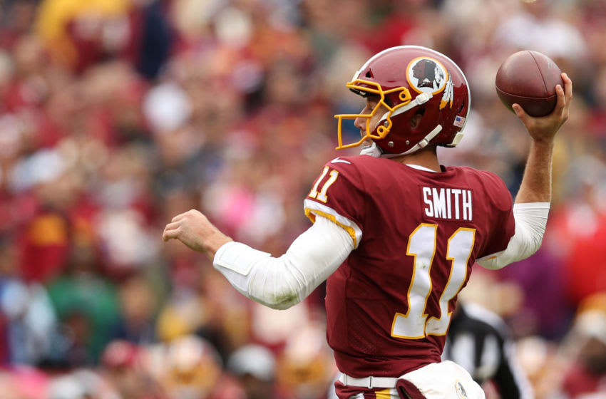 LANDOVER, MD - OCTOBER 14: Quarterback Alex Smith #11 of the Washington Redskins throws a touchdown in the first quarter against the Carolina Panthers at FedExField on October 14, 2018 in Landover, Maryland. (Photo by Patrick Smith/Getty Images)