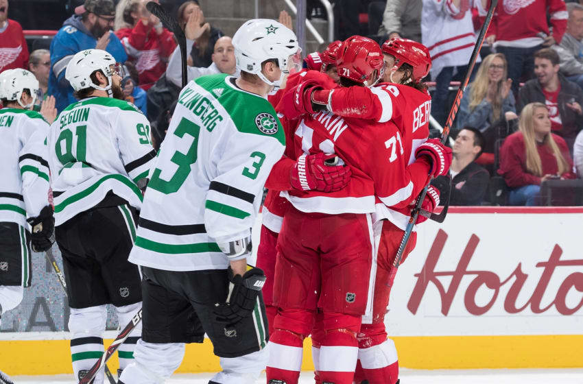 DETROIT, MI - OCTOBER 28: Justin Abdelkader #8 of the Detroit Red Wings celebrates his third period goal with teammates Dylan Larkin #71 and Tyler Bertuzzi #59 as Tyler Seguin #91 and John Klingberg #3 of the Dallas Stars skate past during an NHL game at Little Caesars Arena on October 28, 2018 in Detroit, Michigan. The Wings defeated the Stars 4-2. (Photo by Dave Reginek/NHLI via Getty Images)