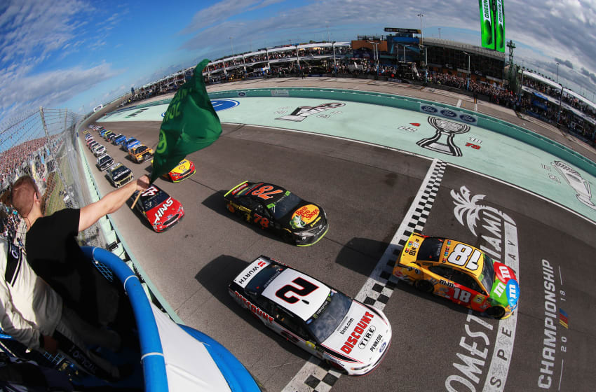 HOMESTEAD, FL - NOVEMBER 18: Kyle Busch, driver of the #18 M&M's Toyota, and Brad Keselowski, driver of the #2 Discount Tire Ford, pass the green flag to start the Monster Energy NASCAR Cup Series Ford EcoBoost 400 at Homestead-Miami Speedway on November 18, 2018 in Homestead, Florida. (Photo by Sean Gardner/Getty Images)
