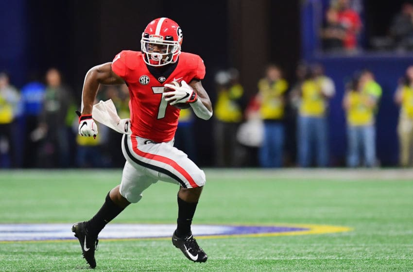 ATLANTA, GA - DECEMBER 01: D'Andre Swift #7 of the Georgia Bulldogs runs with the ball in the first half against the Alabama Crimson Tide during the 2018 SEC Championship Game at Mercedes-Benz Stadium on December 1, 2018 in Atlanta, Georgia. (Photo by Scott Cunningham/Getty Images)