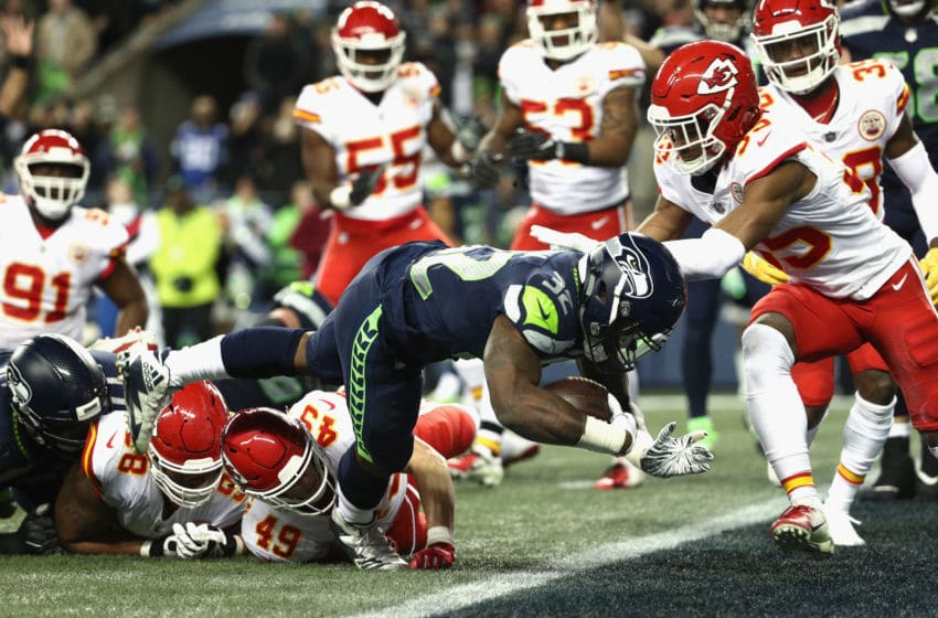 SEATTLE, WA - DECEMBER 23: Chris Carson #32 of the Seattle Seahawks scores a touchdown on a four yard rush during the first quarter of the game against the Kansas City Chiefs at CenturyLink Field on December 23, 2018 in Seattle, Washington. (Photo by Abbie Parr/Getty Images)