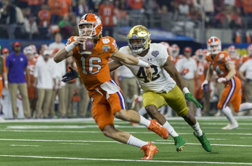 ARLINGTON, TX - DECEMBER 29: Clemson Tigers quarterback Trevor Lawrence (16) gets chased by Notre Dame Fighting Irish defensive lineman Julian Okwara (42) during the CFP Semifinal Goodyear Cotton Bowl Classic game between the Clemson Tigers and the Notre Dame Fighting Irish on December 29, 2018 at the AT&T Stadium in Arlington, Texas. (Photo by Matthew Pearce/Icon Sportswire via Getty Images)