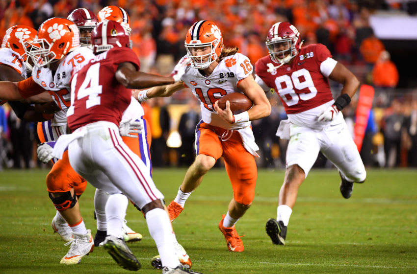 SANTA CLARA, CA - JANUARY 07: Trevor Lawrence #16 of the Clemson Tigers rushes against the Alabama Crimson Tide during the College Football Playoff National Championship held at Levi's Stadium on January 7, 2019 in Santa Clara, California. Clemson defeated Alabama 44-16. (Photo by Jamie Schwaberow/Getty Images)