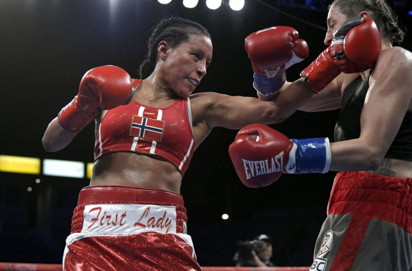 CARSON, CA - DECEMBER 08: Cecilia Braekhus (in red) vs. Aleksandra Lopes (Photo by John McCoy/Getty Images)