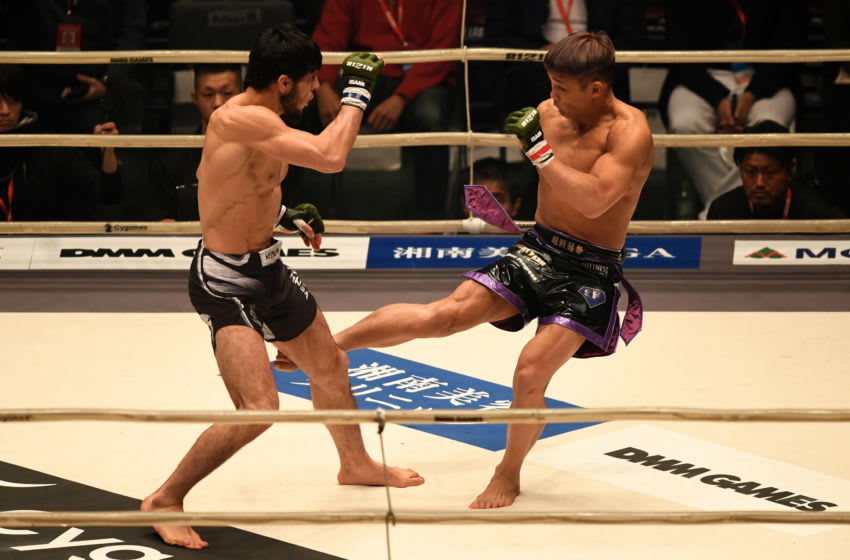 SAITAMA, JAPAN - DECEMBER 31: Nobomitsu Tyson of Japan and Tofiq Musayev of Azerbaijan compete in the bout during the RIZIN. 14 at Saitama Super Arena on December 31, 2018 in Saitama, Japan. (Photo by Etsuo Hara/Getty Images)