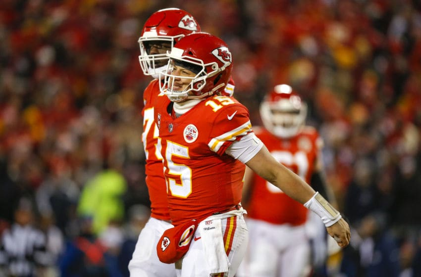 KANSAS CITY, MO - JANUARY 20: Quarterback Patrick Mahomes #15 of the Kansas City Chiefs grimaces after being hit during the AFC Championship Game against the New England Patriots at Arrowhead Stadium on January 20, 2019 in Kansas City, Missouri. (Photo by David Eulitt/Getty Images)