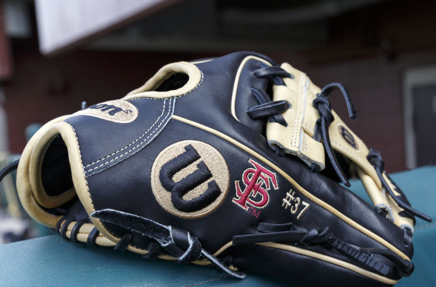 TALLAHASSEE, FL - FEBRUARY 15: A general view the Wilson Baseball Glove of Outfielder Tim Becker #37 of the Florida State Seminoles in the dugout before the game against the Maine Black Bears at Dick Howser Stadium on the campus of Florida State University on February 15, 2019 in Tallahassee, Florida. The 11th Ranked Florida State defeated the Maine Black Bears on Opening Day in a no-hitter 11 to 0. (Photo by Don Juan Moore/Getty Images)