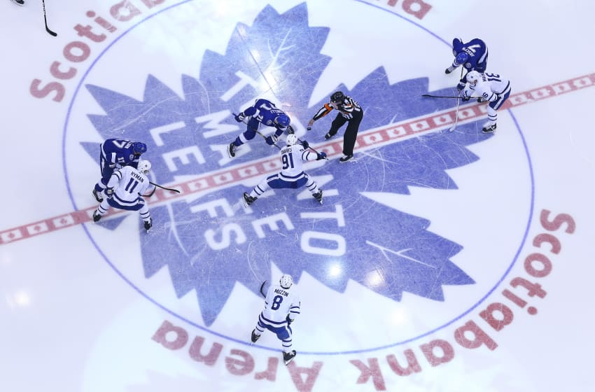 TORONTO, ON - MARCH 11: Anthony Cirelli #71 of the Tampa Bay Lightning takes a faceoff against John Tavares #91 of the Toronto Maple Leafs during an NHL game at Scotiabank Arena on March 11, 2019 in Toronto, Ontario, Canada. The Lightning defeated the Maple Leafs 6-2. (Photo by Claus Andersen/Getty Images)
