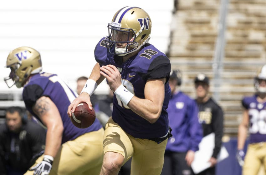 SEATTLE, WA - APRIL 27: Washington Huskies quarterback Jacob Eason (10) runs for positive during the University of Washington Spring Game at Husky Stadium on Saturday, April 27, 2019 in Seattle, WA. (Photo by Joseph Weiser/Icon Sportswire via Getty Images)