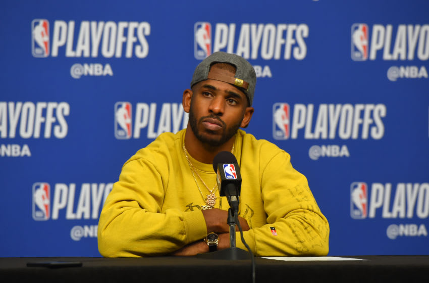 HOUSTON, TX - MAY 10: Chris Paul #3 of the Houston Rockets is interviewed after a game against the Golden State Warriors after Game Six of the Western Conference Semifinals of the 2019 NBA Playoffs on May 10, 2019 at the Toyota Center in Houston, Texas. NOTE TO USER: User expressly acknowledges and agrees that, by downloading and/or using this photograph, user is consenting to the terms and conditions of the Getty Images License Agreement. Mandatory Copyright Notice: Copyright 2019 NBAE (Photo by Bill Baptist/NBAE via Getty Images)