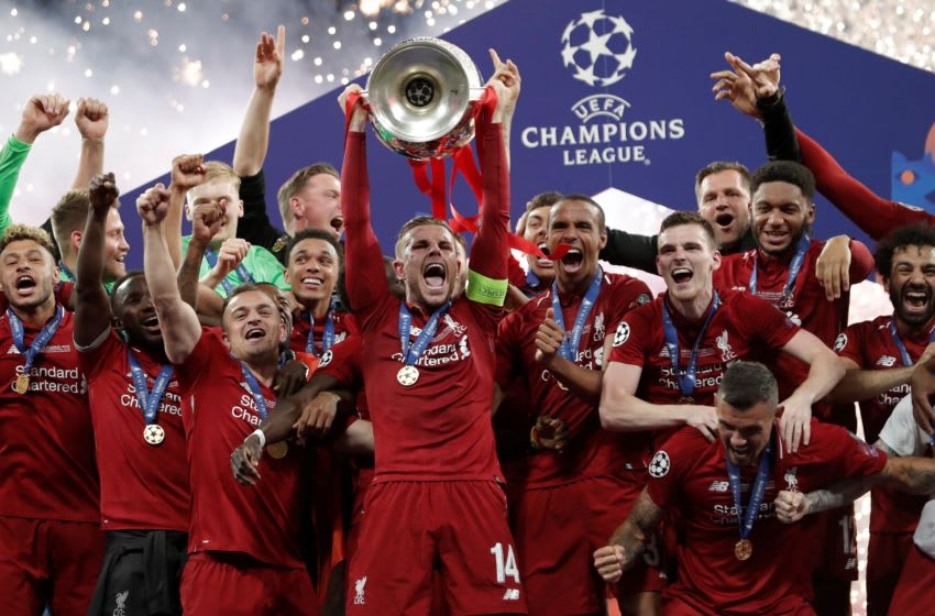 MADRID, SPAIN - JUNE 01: Liverpool team celebrate with the Champions League Trophy after winning the UEFA Champions League Final between Tottenham Hotspur and Liverpool at the Wanda Metropolitano in Madrid, Spain on June 01, 2019. (Photo by Burak Akbulut/Anadolu Agency/Getty Images)