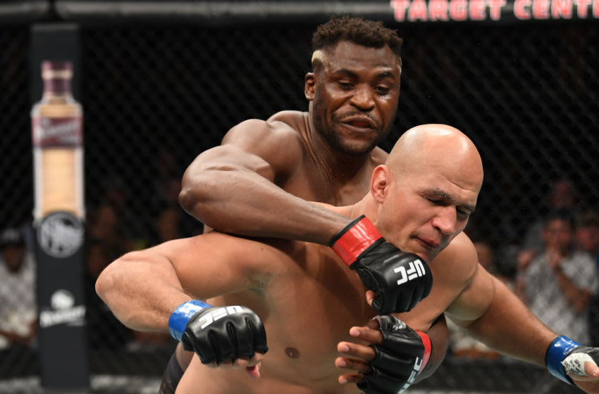 MINNEAPOLIS, MN - JUNE 29: (L-R) Francis Ngannou of Cameroon punches Junior Dos Santos of Brazil in their heavyweight bout during the UFC Fight Night event at the Target Center on June 29, 2019 in Minneapolis, Minnesota. (Photo by Josh Hedges/Zuffa LLC/Zuffa LLC via Getty Images)