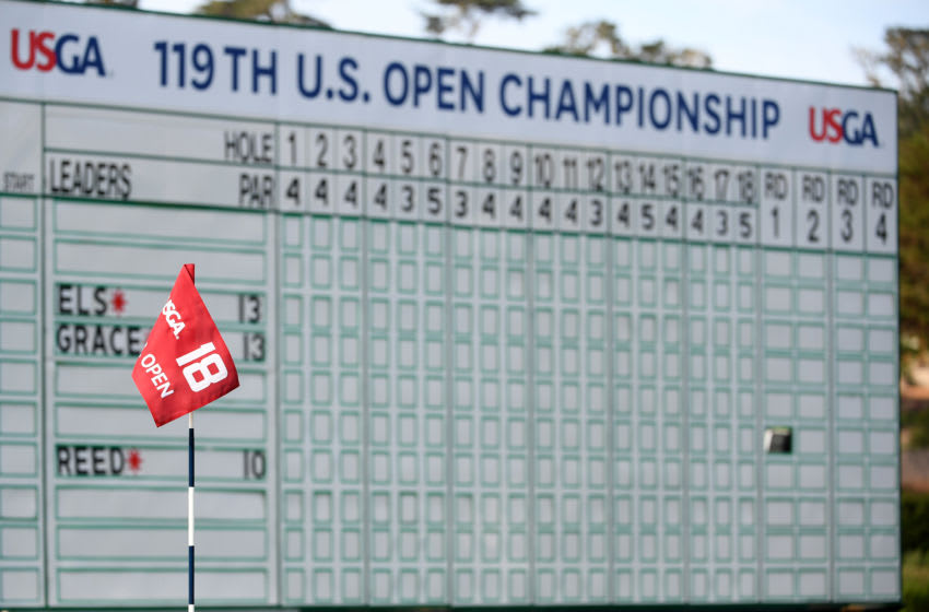 PEBBLE BEACH, CALIFORNIA - JUNE 10: A general view of the 18th flag and the leaderboard is seen during a practice round prior to the 2019 U.S. Open at Pebble Beach Golf Links on June 10, 2019 in Pebble Beach, California. (Photo by Ross Kinnaird/Getty Images)