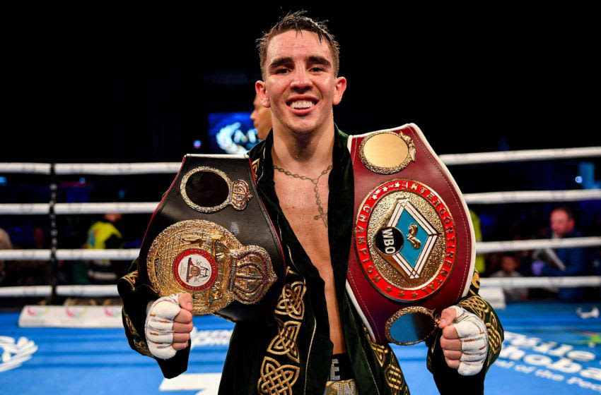 Michael Conlan with title belts . (Photo By Ramsey Cardy/Sportsfile via Getty Images)