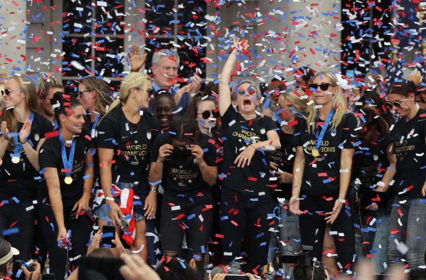 NEW YORK, NEW YORK - JULY 10: Members of the United States Women's National Soccer Team are honored at a ceremony at City Hall on July 10, 2019 in New York City. The honor followed a ticker tape parade up lower Manhattan's