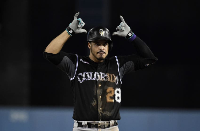 LOS ANGELES, CA - SEPTEMBER 04: Nolan Arenado #28 of the Colorado Rockies reacts after hitting a base hit off of starting pitcher Hyun-Jin Ryu #99 of the Los Angeles Dodgers during the fifth inning at Dodger Stadium on September 4, 2019 in Los Angeles, California. (Photo by Kevork Djansezian/Getty Images)