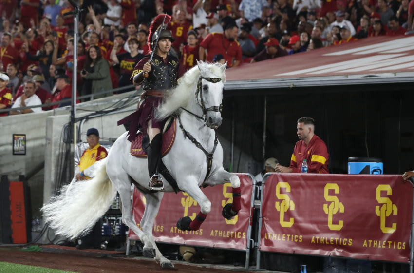 USC mascot Traveler leaps as he runs around the Coliseum (Photo by Peter Joneleit/Icon Sportswire via Getty Images)