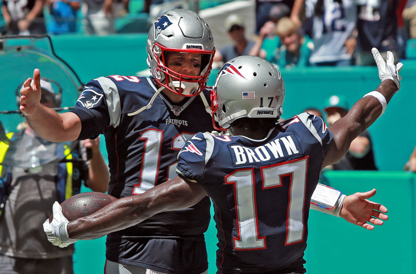 MIAMI , MA. - SEPTEMBER 15: Tom Brady #12 of the New England Patriots celebrates Antonio Brown's #17 touchdown during the second quarter of the NFL game against the Miami Dolphins at the Hard Rock Stadium on September 15, 2019 in Miami , Florida. (Staff Photo By Matt Stone/MediaNews Group/Boston Herald)