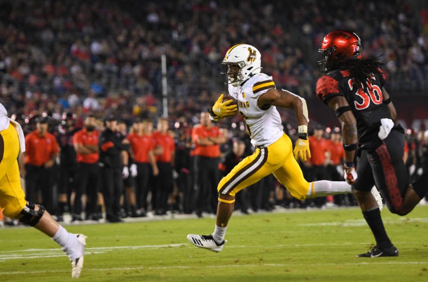 Wyoming Cowboys running back Xazavian Valladay (6) runs with the ball (Photo by Justin Fine/Icon Sportswire via Getty Images)
