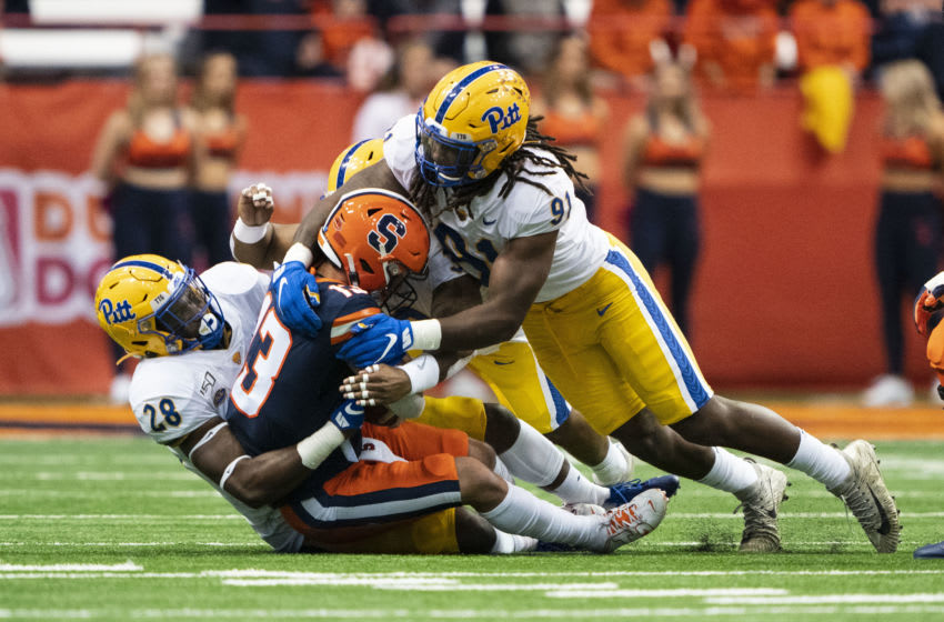 SYRACUSE, NY - OCTOBER 18: Pittsburgh Panthers Linebacker Kylan Johnson (28) sacks Syracuse Orange Quarterback Tommy DeVito (13) along with Pittsburgh Panthers Defensive Lineman Patrick Jones II (91) during the first quarter of the game between the Pittsburgh Panthers and the Syracuse Orange on October 18, 2019, at the Carrier Dome in Syracuse, NY. (Photo by Gregory Fisher/Icon Sportswire via Getty Images)