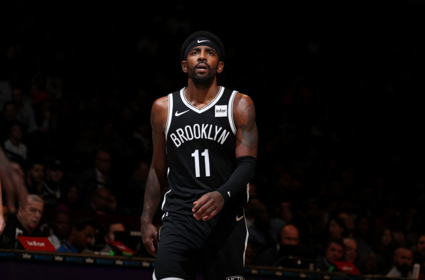 BROOKLYN, NY - OCTOBER 23: Kyrie Irving #11 of the Brooklyn Nets looks on against the Minnesota Timberwolves on October 23, 2019 at Barclays Center in Brooklyn, New York. NOTE TO USER: User expressly acknowledges and agrees that, by downloading and or using this Photograph, user is consenting to the terms and conditions of the Getty Images License Agreement. Mandatory Copyright Notice: Copyright 2019 NBAE (Photo by Nathaniel S. Butler/NBAE via Getty Images)