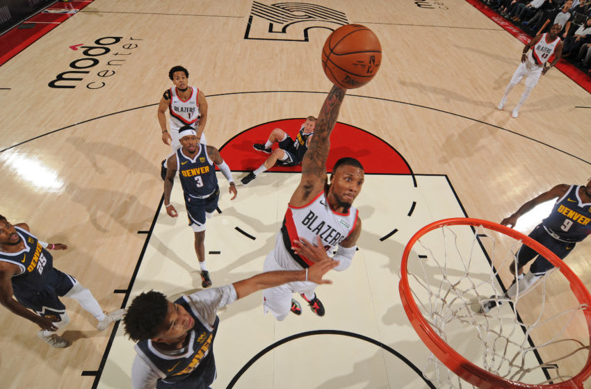 PORTLAND, OR - OCTOBER 23: Damian Lillard #0 of the Portland Trail Blazers dunks the ball against the Denver Nuggets on October 23, 2019 at the Moda Center Arena in Portland, Oregon. NOTE TO USER: User expressly acknowledges and agrees that, by downloading and or using this photograph, user is consenting to the terms and conditions of the Getty Images License Agreement. Mandatory Copyright Notice: Copyright 2019 NBAE (Photo by Cameron Browne/NBAE via Getty Images)