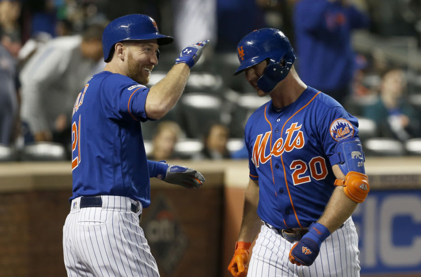 NEW YORK, NEW YORK - SEPTEMBER 27: (NEW YORK DAILIES OUT) Pete Alonso #20 of the New York Mets celebrates with teammate Todd Frazier #21 of the New York Mets after his first inning home run against the Atlanta Braves at Citi Field on September 27, 2019 in New York City. The home run was Alonso's 52nd of the season tying the single season rookie mark set in 2017 by Aaron Judge. The Mets defeated the Braves 4-2. (Photo by Jim McIsaac/Getty Images)