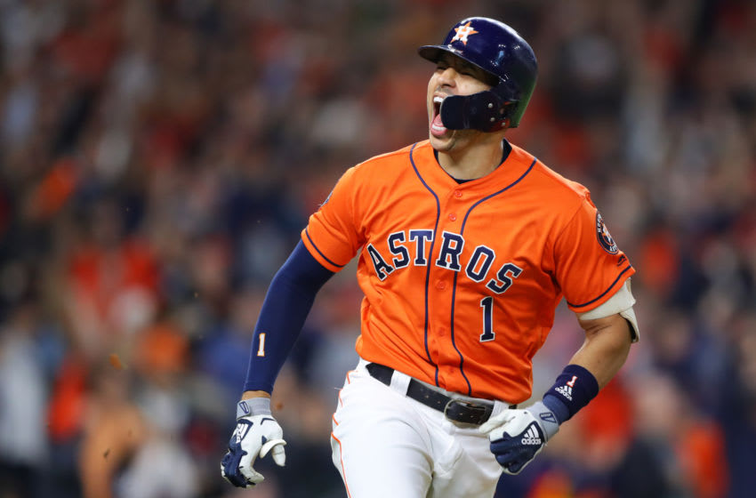 HOUSTON, TX - OCTOBER 30: Carlos Correa #1 of the Houston Astros reacts after hitting an RBI single in the fifth inning during Game 7 of the 2019 World Series between the Washington Nationals and the Houston Astros at Minute Maid Park on Wednesday, October 30, 2019 in Houston, Texas. (Photo by Alex Trautwig/MLB Photos via Getty Images)