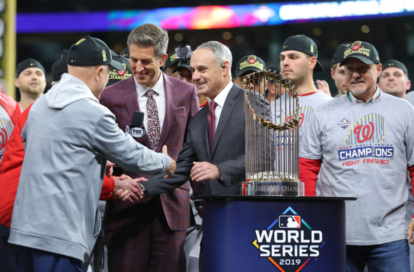 HOUSTON, TX - OCTOBER 30: Major League Baseball Commissioner Robert D. Manfred Jr. shakes hands with Washington Nationals owner Mark Lerner during the World Series trophy presentation after the Nationals defeat the Houston Astros in Game 7 to win the 2019 World Series at Minute Maid Park on Wednesday, October 30, 2019 in Houston, Texas. (Photo by Alex Trautwig/MLB Photos via Getty Images)
