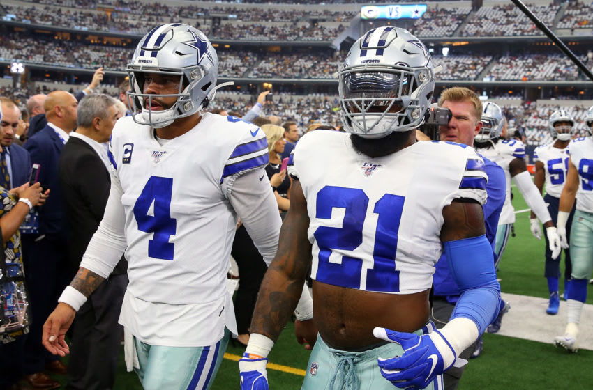 ARLINGTON, TEXAS - OCTOBER 06: Dak Prescott #4 and Ezekiel Elliott #21 of the Dallas Cowboys head back to the locker room after warmups before the game against the Green Bay Packers at AT&T Stadium on October 06, 2019 in Arlington, Texas. (Photo by Richard Rodriguez/Getty Images)