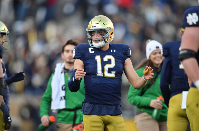 SOUTH BEND, IN - NOVEMBER 16: Notre Dame Fighting Irish quarterback Ian Book (12) reacts to a play in game action during a game between the Notre Dame Fighting Irish and the Navy Midshipmen on November 16, 2019 at Notre Dame Stadium in South Bend, IN. (Photo by Robin Alam/Icon Sportswire via Getty Images)