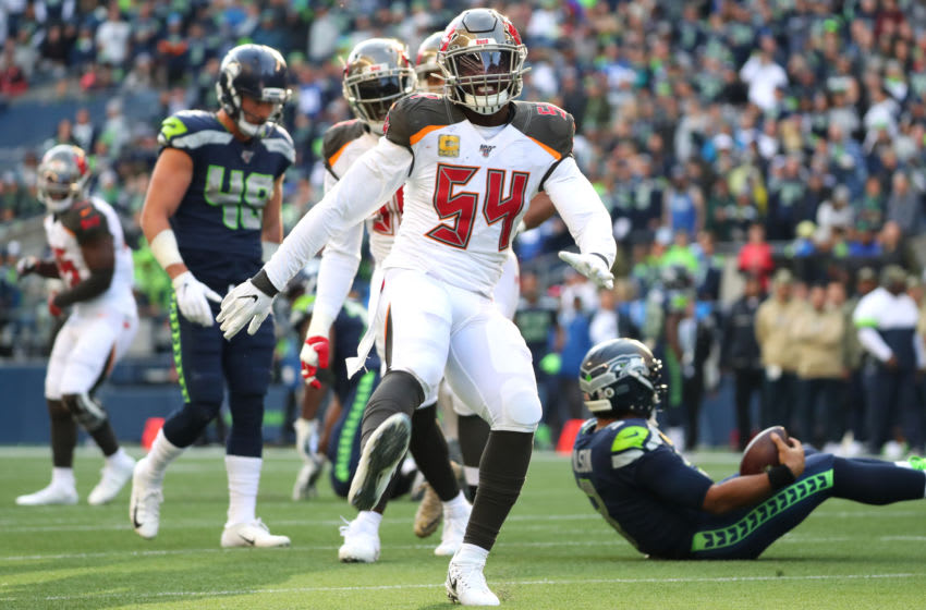 SEATTLE, WASHINGTON - NOVEMBER 03: Lavonte David #54 of the Tampa Bay Buccaneers celebrates after sacking Russell Wilson #3 of the Seattle Seahawks in the third quarter during their game at CenturyLink Field on November 03, 2019 in Seattle, Washington. (Photo by Abbie Parr/Getty Images)
