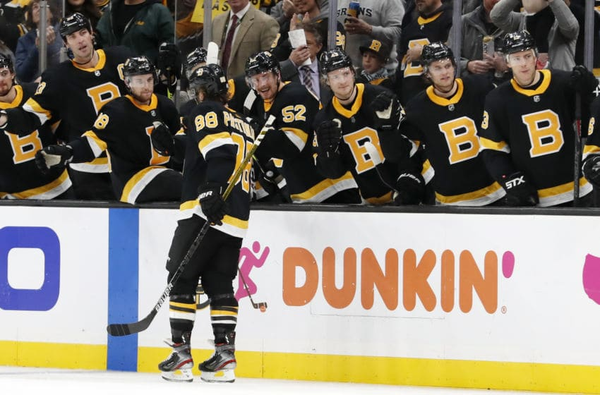 BOSTON, MA - NOVEMBER 29: Boston Bruins right wing David Pastrnak (88) skates by the bench after scoring during a game between the Boston Bruins and the New York Rangers on November 29, 2019, at TD Garden in Boston, Massachusetts. (Photo by Fred Kfoury III/Icon Sportswire via Getty Images)
