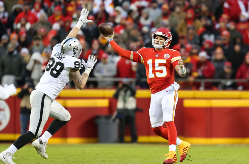 KANSAS CITY, MO - DECEMBER 01: Kansas City Chiefs quarterback Patrick Mahomes (15) throws a sidearm pass around Oakland Raiders defensive end Maxx Crosby (98) in the second quarter of an AFC West game between the Oakland Raiders and Kansas City Chiefs on December 1, 2019 at Arrowhead Stadium in Kansas City, MO. (Photo by Scott Winters/Icon Sportswire via Getty Images)