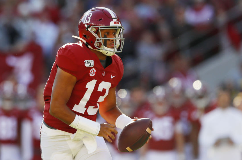 TUSCALOOSA, ALABAMA - NOVEMBER 09: Tua Tagovailoa #13 of the Alabama Crimson Tide runs with the ball during the first half against the LSU Tigers in the game at Bryant-Denny Stadium on November 09, 2019 in Tuscaloosa, Alabama. (Photo by Kevin C. Cox/Getty Images)