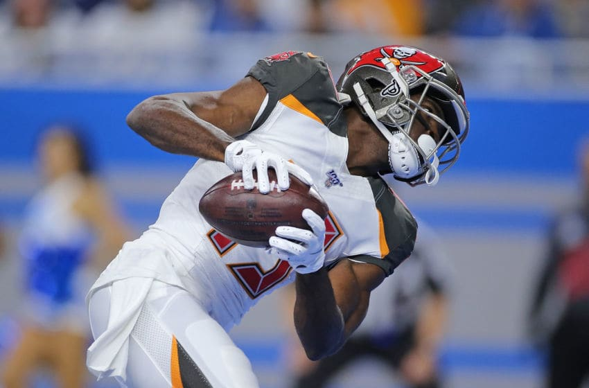 DETROIT, MI - DECEMBER 15: Breshad Perriman #19 of the Tampa Bay Buccaneers scores a first quarter touchdown during the game against the Detroit Lions at Ford Field on December 15, 2019 in Detroit, Michigan. (Photo by Leon Halip/Getty Images)