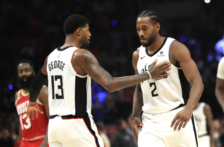Kawhi Leonard, Paul George. Photo by Sean M. Haffey/Getty Images