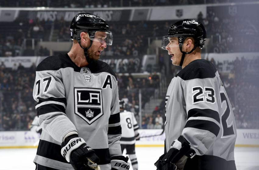 LOS ANGELES, CA - NOVEMBER 23: Jeff Carter #77 and Dustin Brown #23 of the Los Angeles Kings talk during the third period of the game against the Arizona Coyotes at STAPLES Center on November 23, 2019 in Los Angeles, California. (Photo by Juan Ocampo/NHLI via Getty Images)
