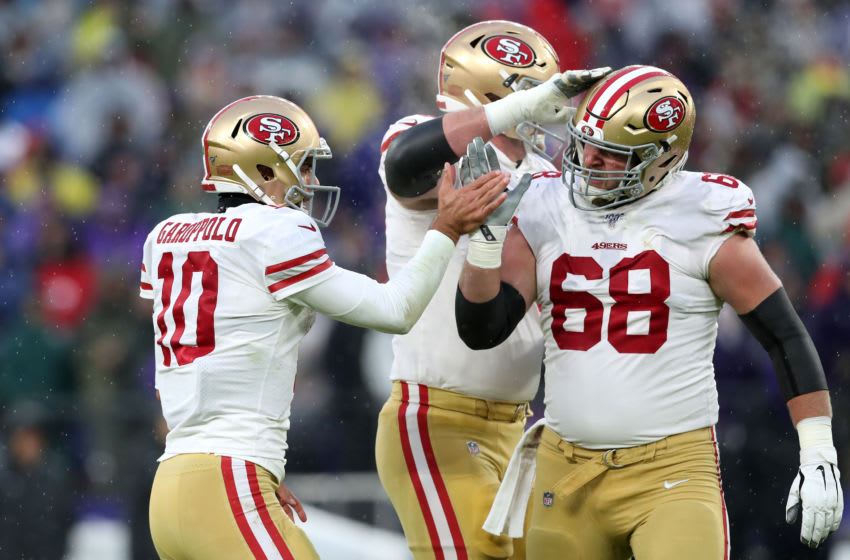 BALTIMORE, MARYLAND - DECEMBER 01: Jimmy Garoppolo #10 of the San Francisco 49ers celebrates a touchdown with Mike Person #68 against the Baltimore Ravens at M&T Bank Stadium on December 01, 2019 in Baltimore, Maryland. (Photo by Rob Carr/Getty Images)