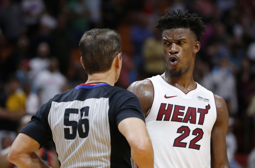 Jimmy Butler #22 of the Miami Heat reacts while talking with referee Mark Ayotte (Photo by Michael Reaves/Getty Images)