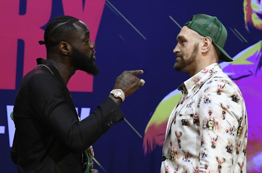 Deontay Wilder (L) and Tyson Fury get together during a news conference. (Photo by Kevork Djansezian/Getty Images)