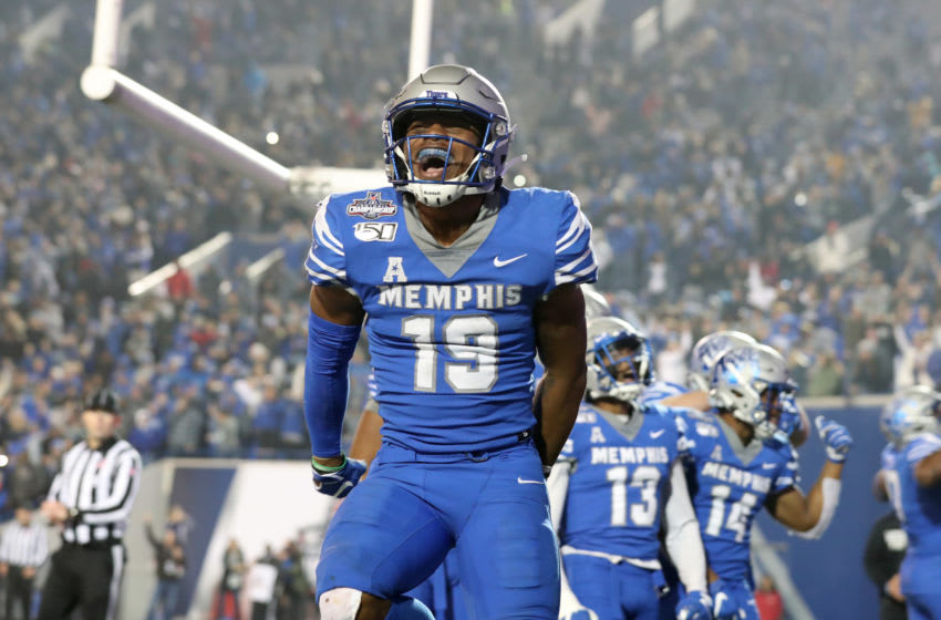 MEMPHIS, TN - DECEMBER 7: Kenneth Gainwell #19 of the Memphis Tigers celebrates a touchdown against the Cincinnati Bearcats during the American Athletic Conference Championship game on December 7, 2019 at Liberty Bowl Memorial Stadium in Memphis, Tennessee. Memphis defeated Cincinnati 29-24. (Photo by Joe Murphy/Getty Images)