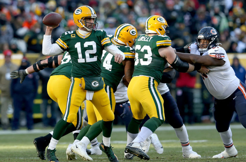 GREEN BAY, WISCONSIN - DECEMBER 15: Quarterback Aaron Rodgers #12 of the Green Bay Packers drops back to pass over the defense of the Chicago Bears during the game at Lambeau Field on December 15, 2019 in Green Bay, Wisconsin. (Photo by Dylan Buell/Getty Images)