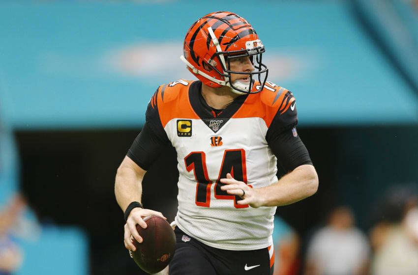 MIAMI, FLORIDA - DECEMBER 22: Andy Dalton #14 of the Cincinnati Bengals scrambles with the ball against the Miami Dolphins during the second quarter at Hard Rock Stadium on December 22, 2019 in Miami, Florida. (Photo by Michael Reaves/Getty Images)