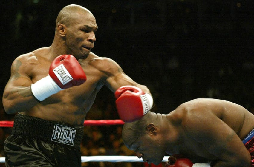 Clifford Etienne (R) ducks under a punch thrown by Mike Tyson. (Photo credit should read JEFF HAYNES/AFP via Getty Images)