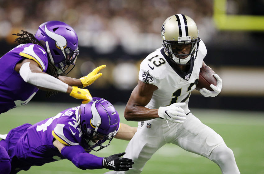 NEW ORLEANS, LOUISIANA - JANUARY 05: Anthony Harris #41 and Andrew Sendejo #34 of the Minnesota Vikings attempt to tackle Michael Thomas #13 of the New Orleans Saints during the first half in the NFC Wild Card Playoff game at Mercedes Benz Superdome on January 05, 2020 in New Orleans, Louisiana. (Photo by Chris Graythen/Getty Images)