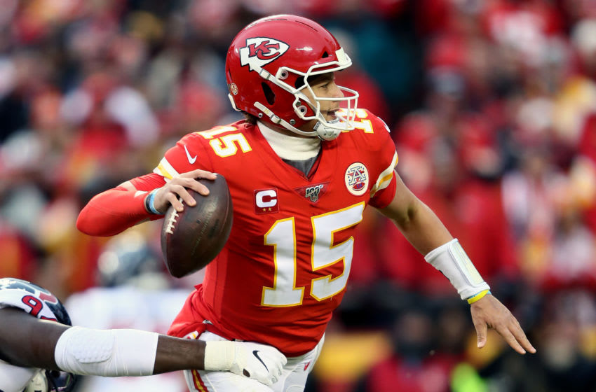 KANSAS CITY, MISSOURI - JANUARY 12: Patrick Mahomes #15 of the Kansas City Chiefs passes the ball against the Houston Texans during the second quarter in the AFC Divisional playoff game at Arrowhead Stadium on January 12, 2020 in Kansas City, Missouri. (Photo by Jamie Squire/Getty Images)
