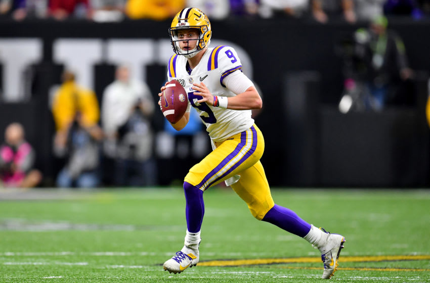 NEW ORLEANS, LOUISIANA - JANUARY 13: Joe Burrow #9 of the LSU Tigers rolls out of the pocket during the second quarter of the College Football Playoff National Championship game against the Clemson Tigers at the Mercedes Benz Superdome on January 13, 2020 in New Orleans, Louisiana. The LSU Tigers topped the Clemson Tigers, 42-25. (Photo by Alika Jenner/Getty Images)